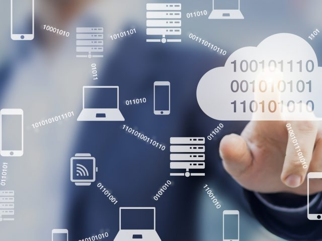 Data transmission and cloud computing concept with a network of servers, computers and devices exchanging binary digital information, person touching button